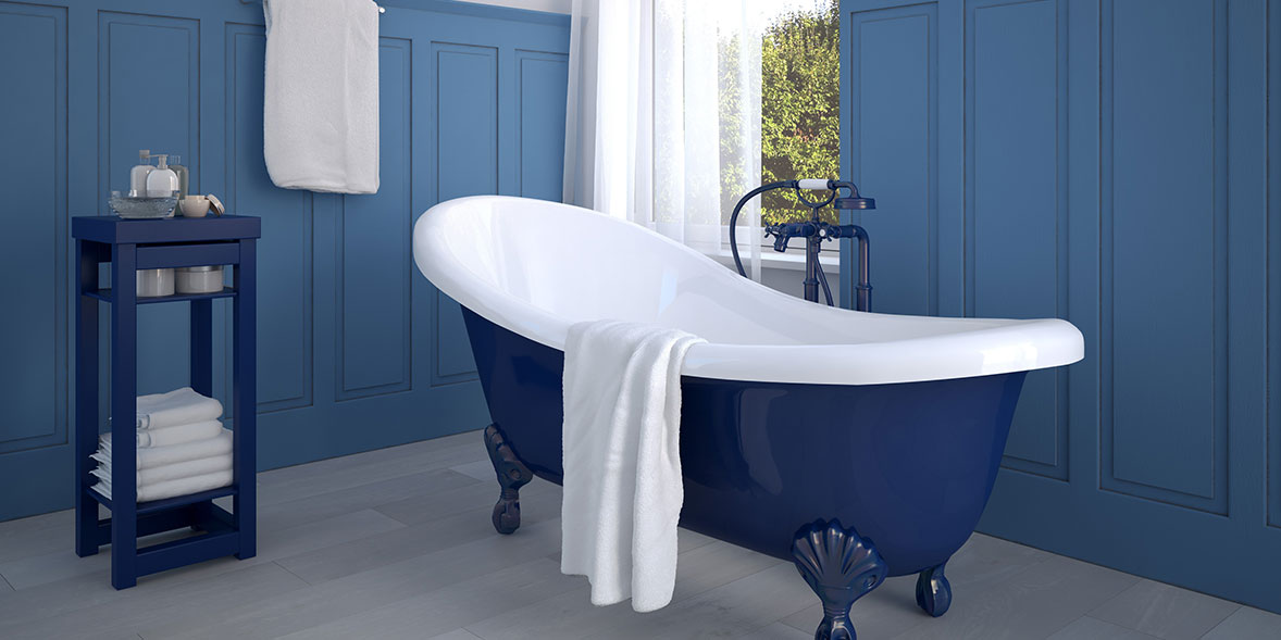 Bathroom wall panels painted blue with a blue roll-top bath