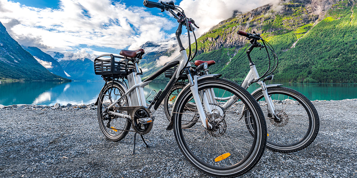 two electric bikes surrounded by mountains