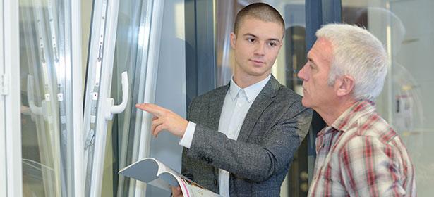 Double glazing salesman talking to customer 478482