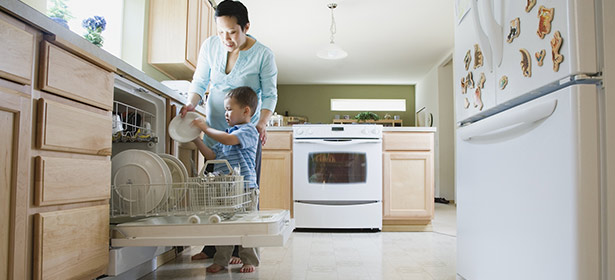 USED_Mother and young son load dishwasher