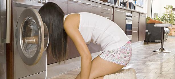 Girl peers into condenser dryer