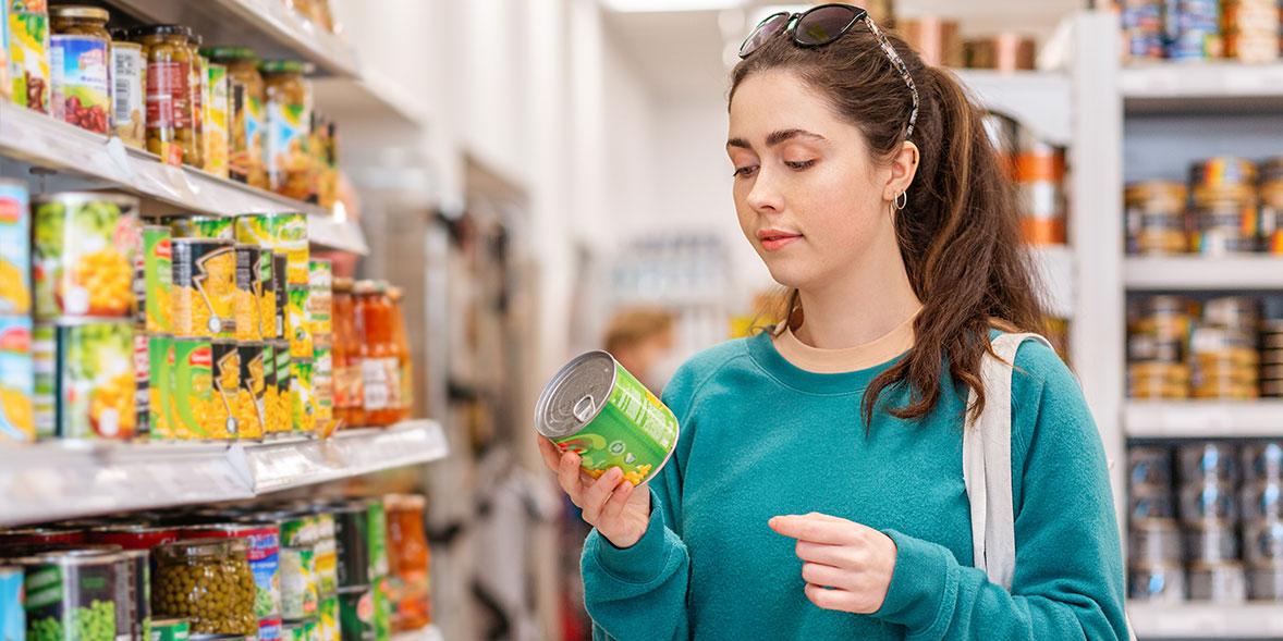 Woman reading sweetcorn label