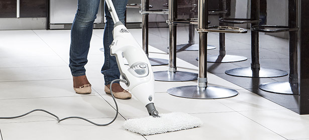 USED_Woman cleaning floor with steam mop