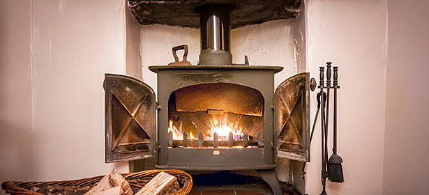 Wood burning stove with doors open