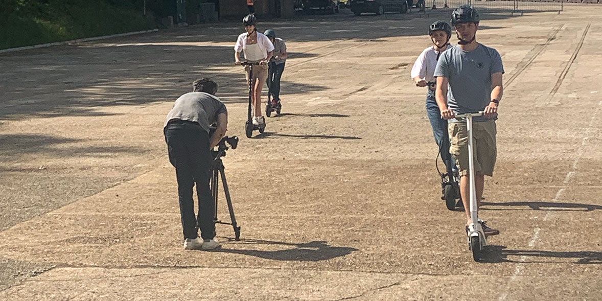 Researchers riding electric scooters