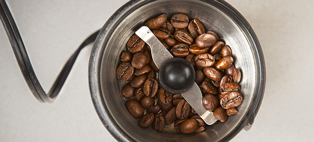 A blade coffee grinder with coffee beans inside