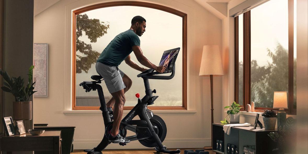 Man riding a Peloton bike