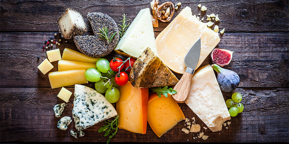 Selection of cheeses laid out on a table