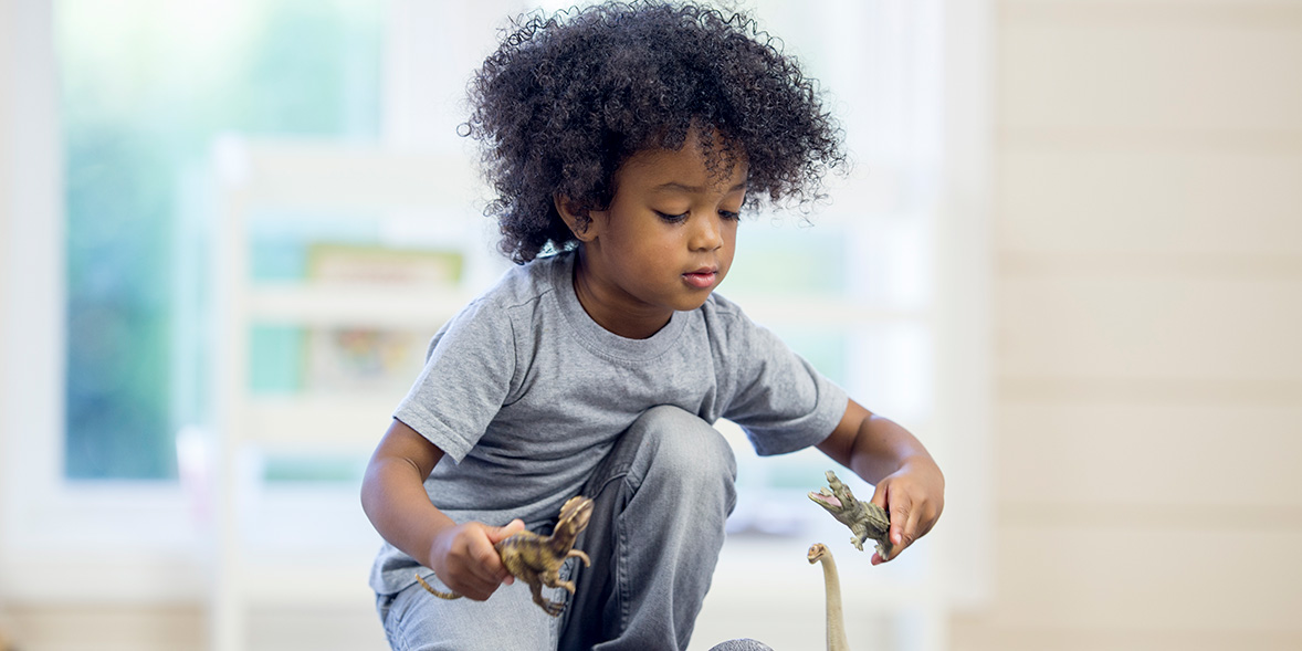 Mixed race child with afro hair