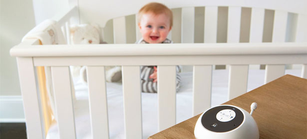 Baby monitor with baby in background