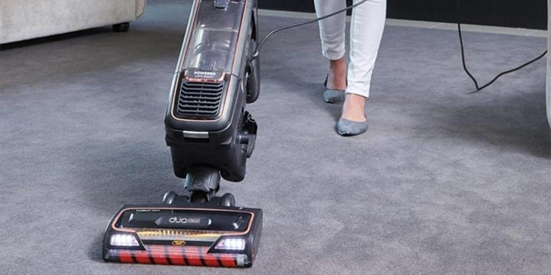 The Shark AZ950UKT vacuum cleaner in use