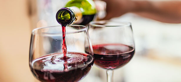 Pouring glass of red wine