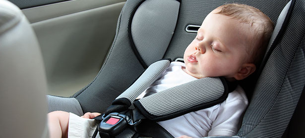 Sleeping baby in child car seat