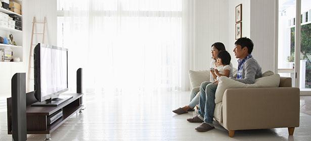 Family watching large TV