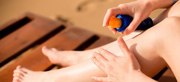 Sun cream being used on legs