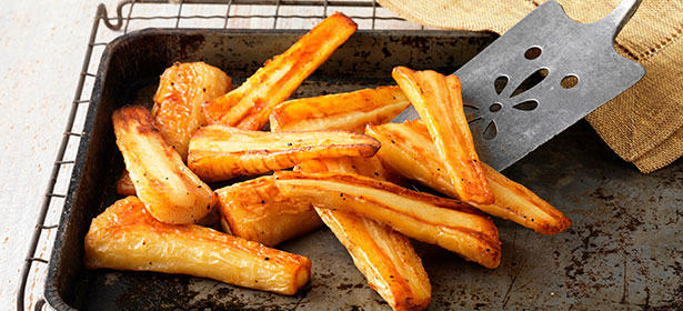 Roasted parsnips in oven tray