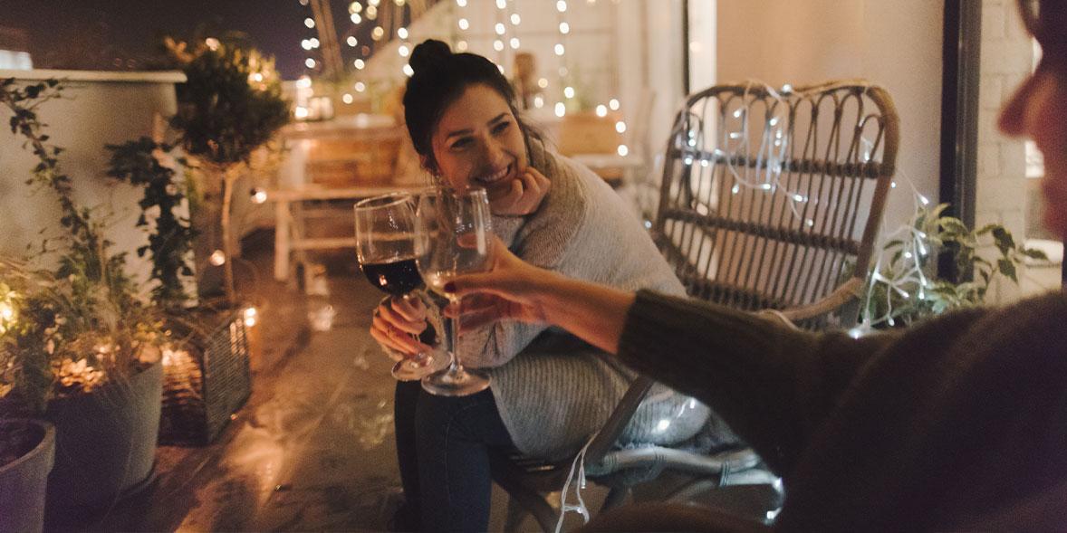 Two friends enjoying wine